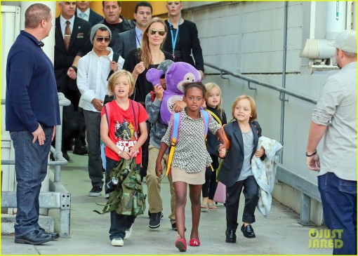 Angelina Jolie and her brood touch down in Sydney **USA ONLY**