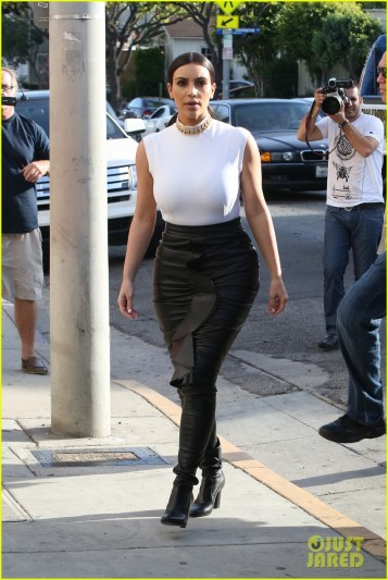 Kim Kardashian Steps Out In A White Sleeveless Top & Leather Skirt