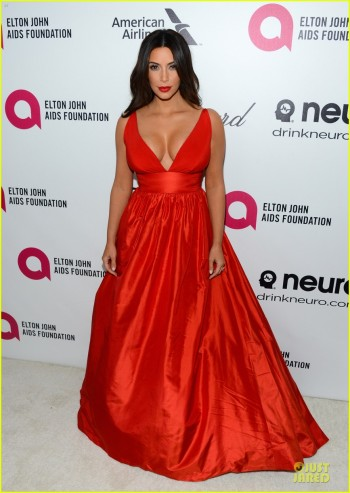 kim-kardashian-bares-cleavage-in-red-dress-at-elton-john-oscars-party-2014-01