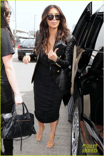 Kim Kardashian heads into LAX to catch a flight