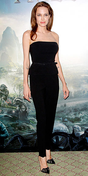 angelina-jolie-elle-fanning-hold-hands-at-maleficent-paris-photo-call-04