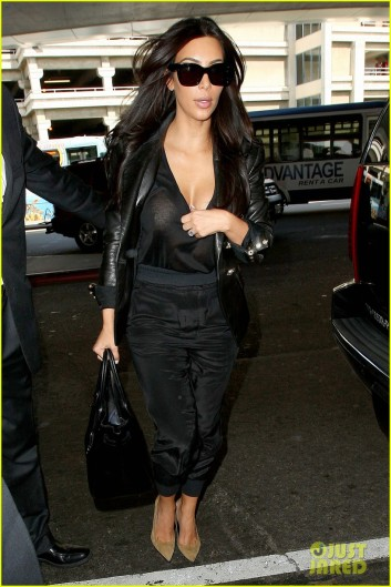 Kim Kardashian bares her cleavage at LAX