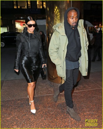 Kim Kardashian only has eyes for Kanye West as he greets her and fixes her collar while out and about in NYC
