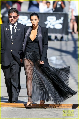 kim-kardashian-wears-a-totally-see-through-skirt-for-kimmel-appearance-14