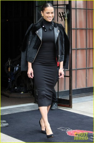Paula Patton steps out in all black while a new doorman gets all excited to see her in NYC